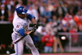 Rickey Henderson of the Toronto Blue Jays swings at a Philadelphia Phillies pitch during game 5 of the World Series at Veterans Stadium in...
