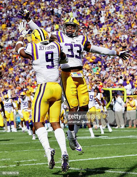 Rickey Jefferson and Jamal Adams of the LSU Tigers celebrate an interception by Jefferson against the Wisconsin Badgers at Lambeau Field on September...