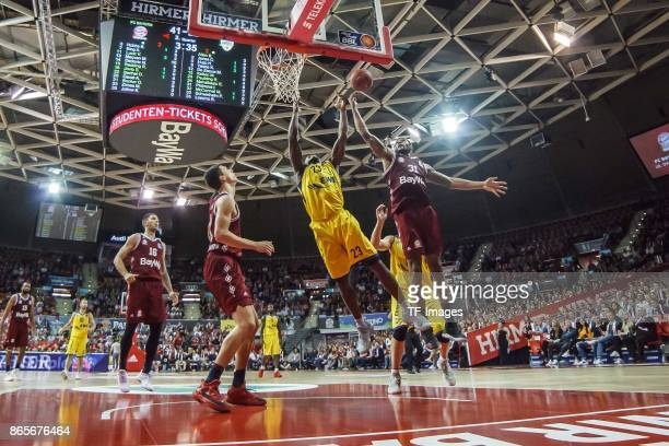 Rickey Paulding of Oldenburg and Devin Booker of Bayern Muenchen battle for the ball during the easyCredit BBL Basketball Bundesliga match between FC...