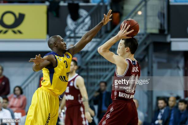Rickey Paulding of Oldenburg and Vladimir Lucic of Bayern Muenchen battle for the ball during the easyCredit BBL Basketball Bundesliga match between...
