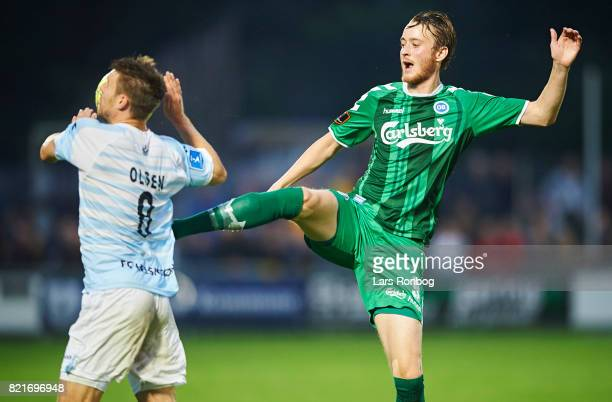 Ricki Olsen of FC Helsingor and Rasmus Jonsson of OB Odense compete for the ball during the Danish Alka Superliga match between FC Helsingor and OB...