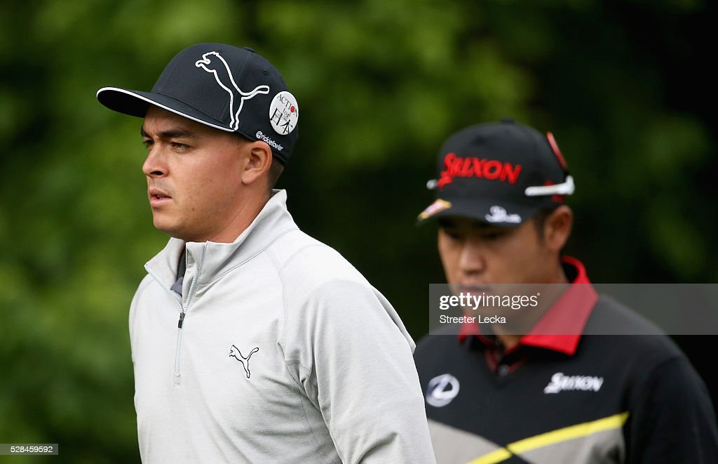 <a gi-track='captionPersonalityLinkClicked' href=/galleries/search?phrase=Rickie+Fowler&family=editorial&specificpeople=4466576 ng-click='$event.stopPropagation()'>Rickie Fowler</a> and <a gi-track='captionPersonalityLinkClicked' href=/galleries/search?phrase=Hideki+Matsuyama&family=editorial&specificpeople=5566852 ng-click='$event.stopPropagation()'>Hideki Matsuyama</a> walk down the 12th fairway during the first round of the 2016 Wells Fargo Championship at Quail Hollow Club on May 5, 2016 in Charlotte, North Carolina.