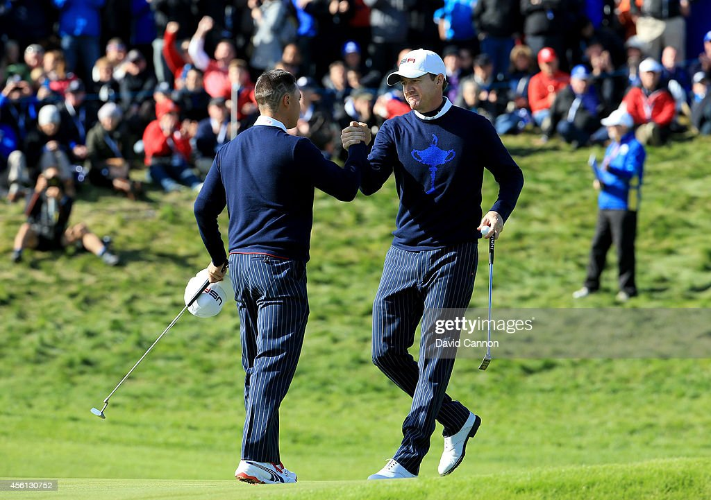 <a gi-track='captionPersonalityLinkClicked' href=/galleries/search?phrase=Rickie+Fowler&family=editorial&specificpeople=4466576 ng-click='$event.stopPropagation()'>Rickie Fowler</a> (L) and <a gi-track='captionPersonalityLinkClicked' href=/galleries/search?phrase=Jimmy+Walker+-+Golfista&family=editorial&specificpeople=11493198 ng-click='$event.stopPropagation()'>Jimmy Walker</a> of the United States celebrate halving their match during the Morning Fourballs of the 2014 Ryder Cup on the PGA Centenary course at the Gleneagles Hotel on September 26, 2014 in Auchterarder, Scotland.