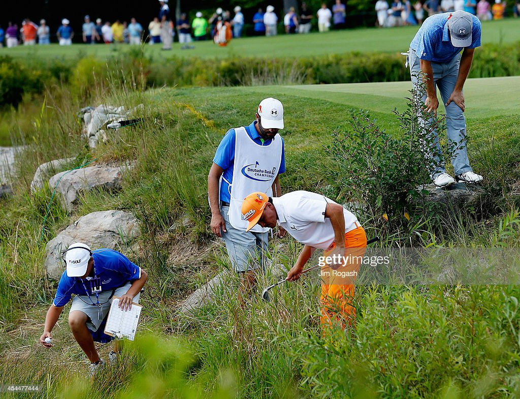 Rickie Fowler and Jordan Spieth look for their balls on the second hole during the final round of the Deutsche Bank Championship at the TPC Boston on September 1, 2014 in Norton, Massachusetts.