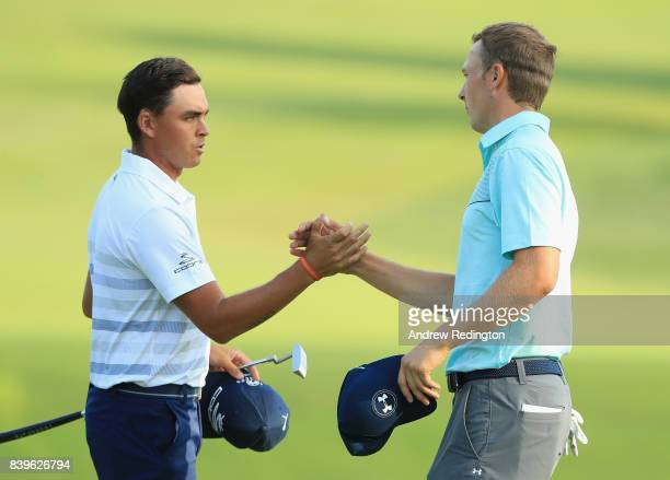 Rickie Fowler and Jordan Spieth of the United States shake hands after finishing on the 18th green during round three of The Northern Trust at Glen...