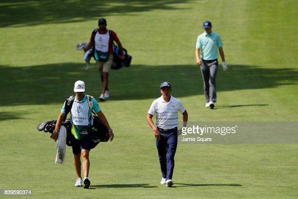 Rickie Fowler and Jordan Spieth of the United States walk on the third hole during round three of The Northern Trust at Glen Oaks Club on August 26...