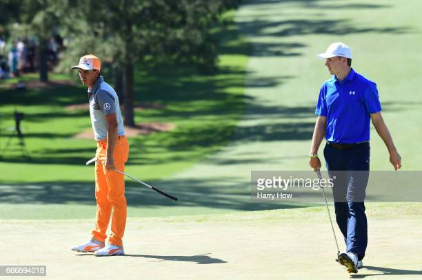 Rickie Fowler and Jordan Spieth of the United States walk the seventh hole during the final round of the 2017 Masters Tournament at Augusta National...