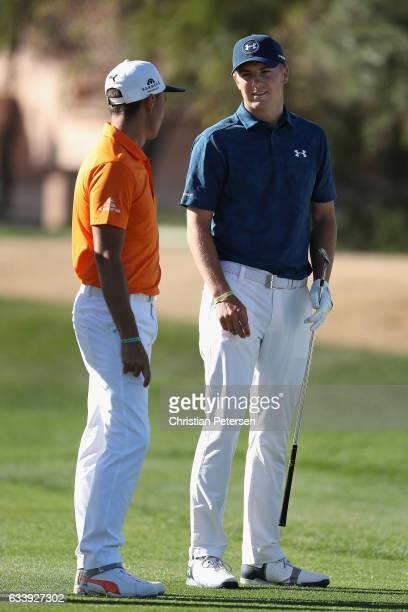 Rickie Fowler and Jordan Spieth talk on the first hole during the final round of the Waste Management Phoenix Open at TPC Scottsdale on February 5...