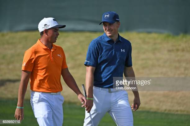 Rickie Fowler and Jordan Spieth walk down the 17th fairway during the final round of the Waste Management Phoenix Open at TPC Scottsdale on February...