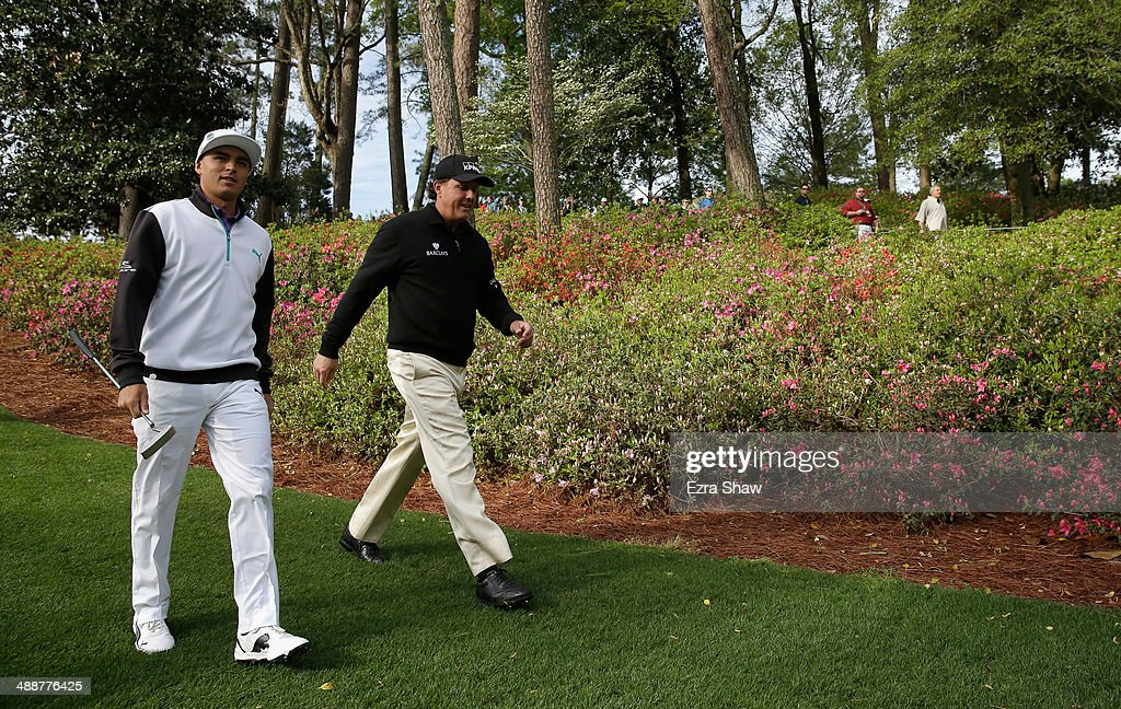 Rickie Fowler and Phil Mickelson walk down the sixth fairway during a practice round at Augusta National Golf Club on April 8, 2014 in Augusta, Georgia.