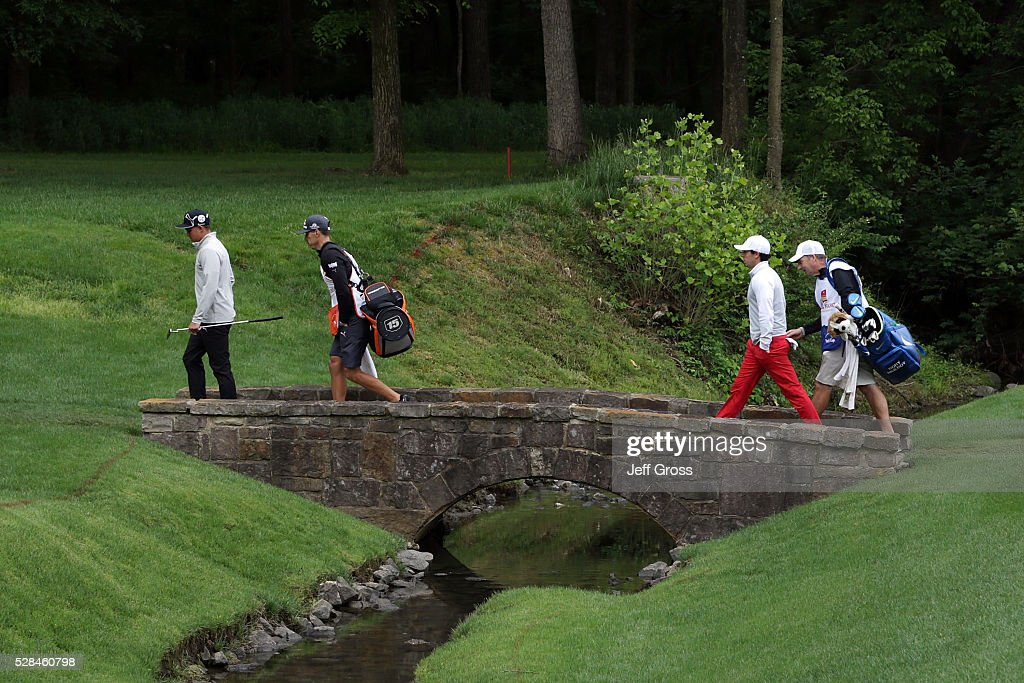 <a gi-track='captionPersonalityLinkClicked' href=/galleries/search?phrase=Rickie+Fowler&family=editorial&specificpeople=4466576 ng-click='$event.stopPropagation()'>Rickie Fowler</a> and (R) Rory McIlroy of Northern Ireland walk across the bridge on the 13th hole during the first round of the Wells Fargo Championship at Quail Hollow Club on May 5, 2016 in Charlotte, North Carolina.
