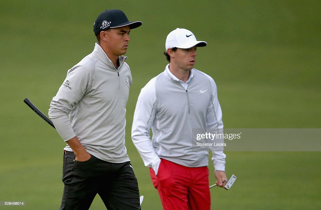 Rickie Fowler and Rory McIlroy wait on the 10th green during the first round of the 2016 Wells Fargo Championship at Quail Hollow Club on May 5, 2016 in Charlotte, North Carolina.