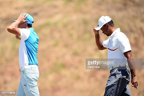 Rickie Fowler and Tiger Woods of the United States walk off the 9th green during the second round of the 115th US Open Championship at Chambers Bay...
