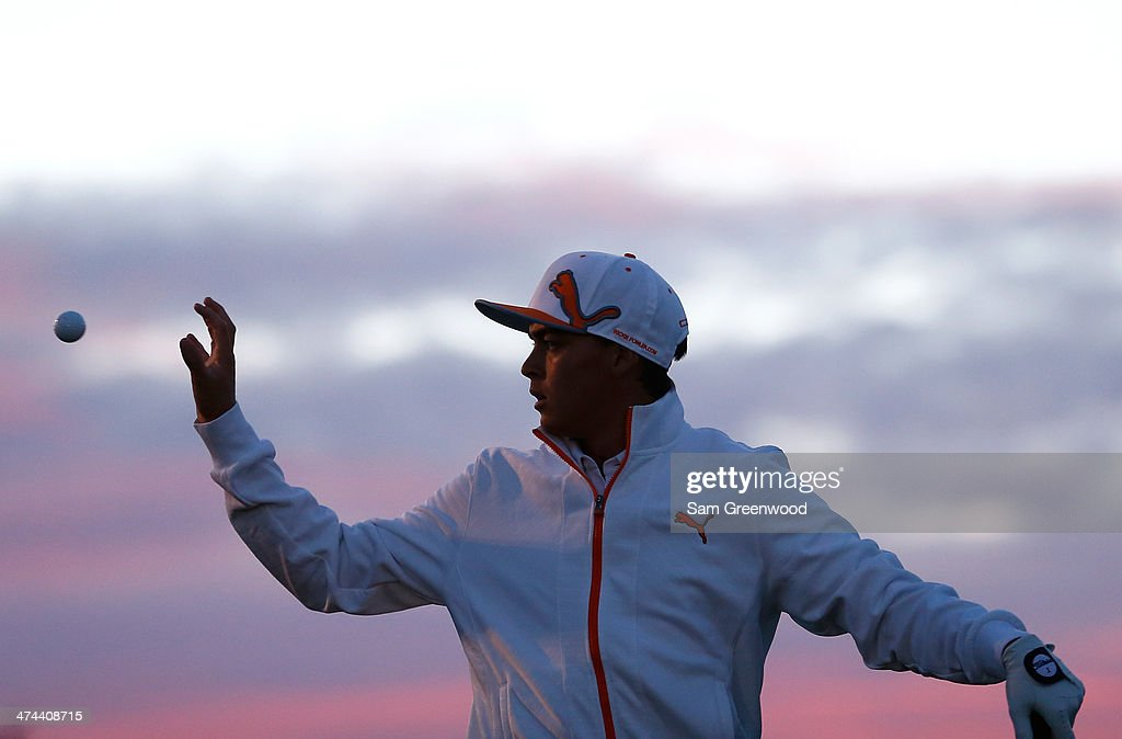 Rickie Fowler catches a ball during practice prior to his semifinal round match against Jason Day of Australia during the World Golf Championships...