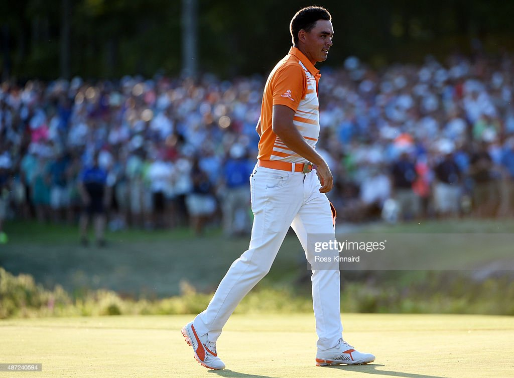 Rickie Fowler celebrates after winning the Deutsche Bank Championship at TPC Boston on September 7 2015 in Norton Massachusetts