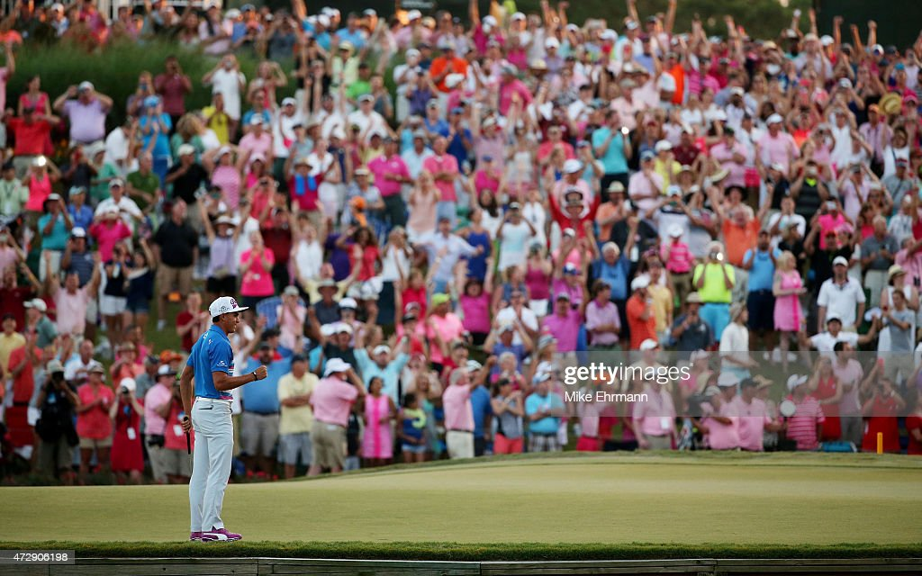 Rickie Fowler celebrates as he wins the playoff in the final round of THE PLAYERS Championship at the TPC Sawgrass Stadium course on May 10 2015 in...