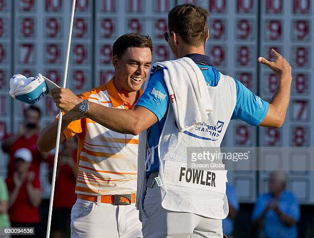 Rickie Fowler celebrates with his caddy Joe Skovron after winning the Deutsche Bank Championship at TPC Boston in Norton MA on Sep 7 2015