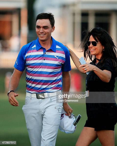 Rickie Fowler celebrates with his mother Lynn Fowler after winning during a playoff in the final round of THE PLAYERS Championship at the TPC...