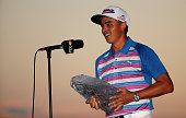 Rickie Fowler celebrates with the winner's trophy after the final round of THE PLAYERS Championship at the TPC Sawgrass Stadium course on May 10 2015...