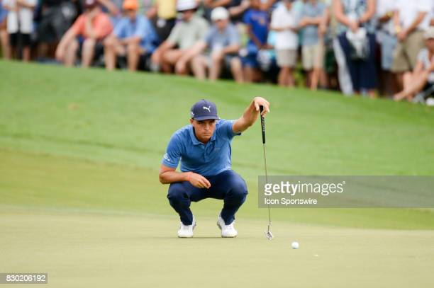 Rickie Fowler eyes his birdie putt on the 10th green during 2nd round action at the PGA Championship at the Quail Hollow Club on August 11 2017 in...