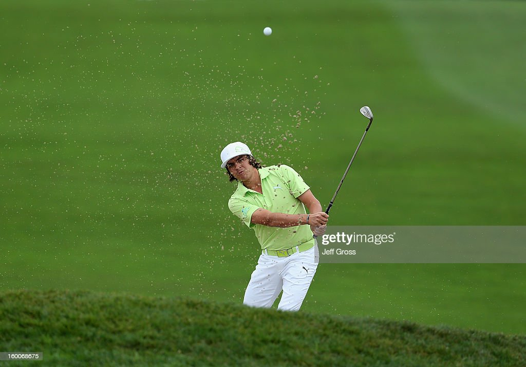 Rickie Fowler hits a bunker shot to the first green during the second round of the Farmers Insurance Open at Torrey Pines North Golf Course on January 25, 2013 in La Jolla, California.