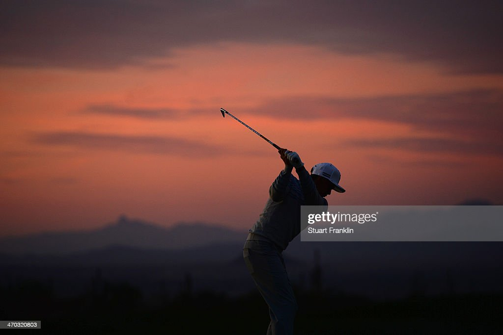 <a gi-track='captionPersonalityLinkClicked' href=/galleries/search?phrase=Rickie+Fowler&family=editorial&specificpeople=4466576 ng-click='$event.stopPropagation()'>Rickie Fowler</a> hits a practice shot prior to the first round of the World Golf Championships - Accenture Match Play Championship at The Golf Club at Dove Mountain on February 19, 2014 in Marana, Arizona.