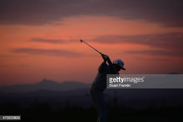 Rickie Fowler hits a practice shot prior to the first round of the World Golf Championships Accenture Match Play Championship at The Golf Club at...
