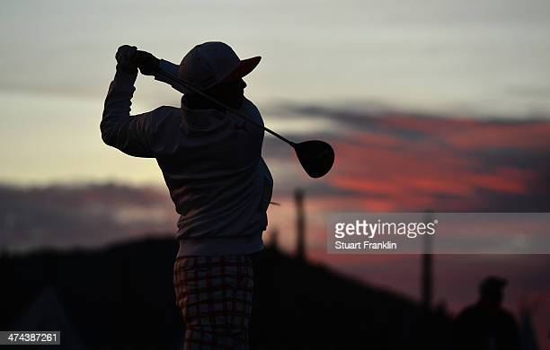Rickie Fowler hits a practice tee shot prior to his semifinal round match against Jason Day of Australia during the World Golf Championships...