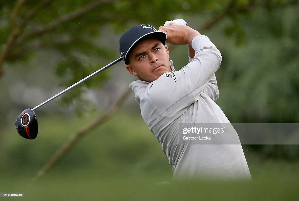 Rickie Fowler hits a tee shot on the 11th hole during the first round of the 2016 Wells Fargo Championship at Quail Hollow Club on May 5, 2016 in Charlotte, North Carolina.