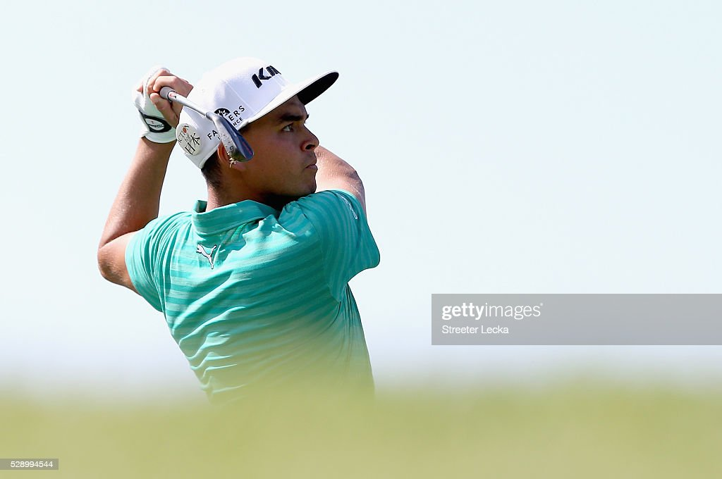 Rickie Fowler hits a tee shot on the 13th hole during the third round of the 2016 Wells Fargo Championship at Quail Hollow Club on May 7 2016 in...