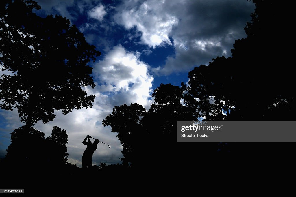 Rickie Fowler hits a tee shot on the 14th hole during the first round of the 2016 Wells Fargo Championship at Quail Hollow Club on May 5, 2016 in Charlotte, North Carolina.