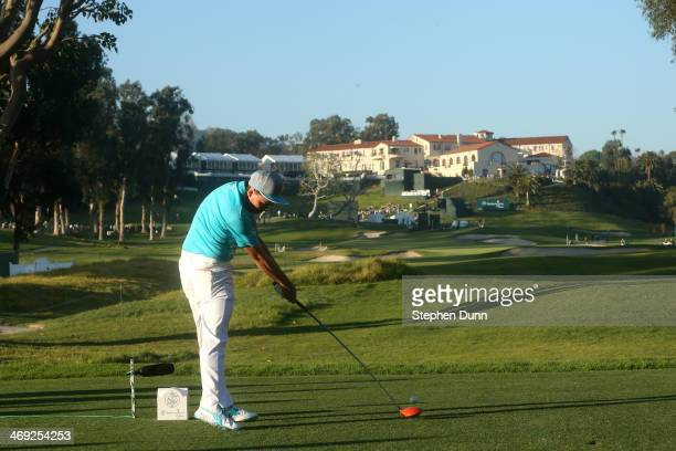 Rickie Fowler hits a tee shot on the 9th hole in the first round of the Northern Trust Open at the Riviera Country Club on February 13 2014 in...