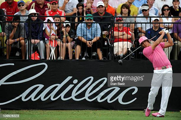 Rickie Fowler hits from the first tee box during the first round of the World Golf ChampionshipsCadillac Championship at TPC Blue Monster at Doral on...