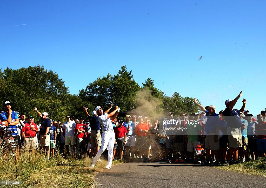 Rickie Fowler hits from the rough on the ninth hole during round three of the Deutsche Bank Championship at TPC Boston on September 6 2015 in Norton...