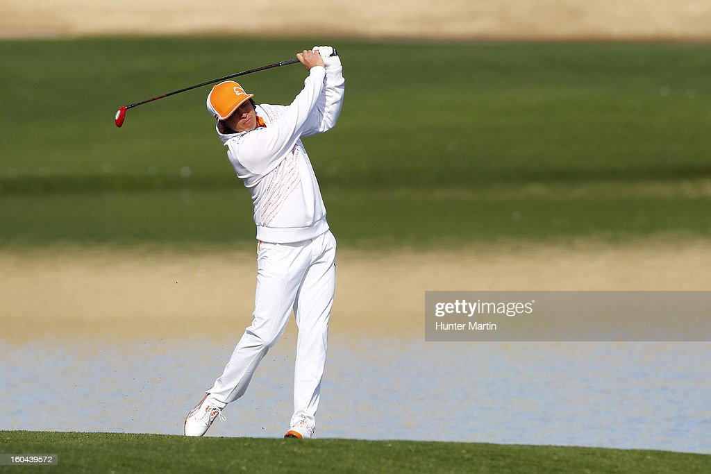 <a gi-track='captionPersonalityLinkClicked' href=/galleries/search?phrase=Rickie+Fowler&family=editorial&specificpeople=4466576 ng-click='$event.stopPropagation()'>Rickie Fowler</a> hits his second shot on the 15th hole during the first round of the Waste Management Phoenix Open at TPC Scottsdale on January 31, 2013 in Scottsdale, Arizona.