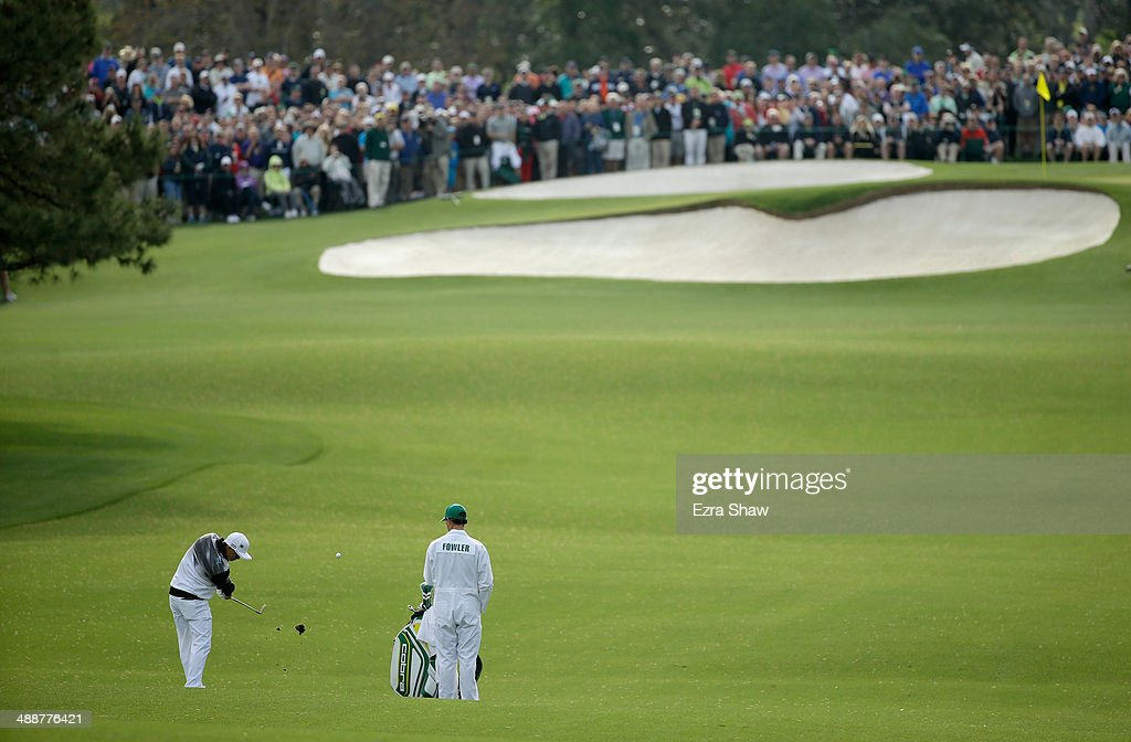 Rickie Fowler hits his second shot on the seventh hole during a practice round at Augusta National Golf Club on April 8, 2014 in Augusta, Georgia.
