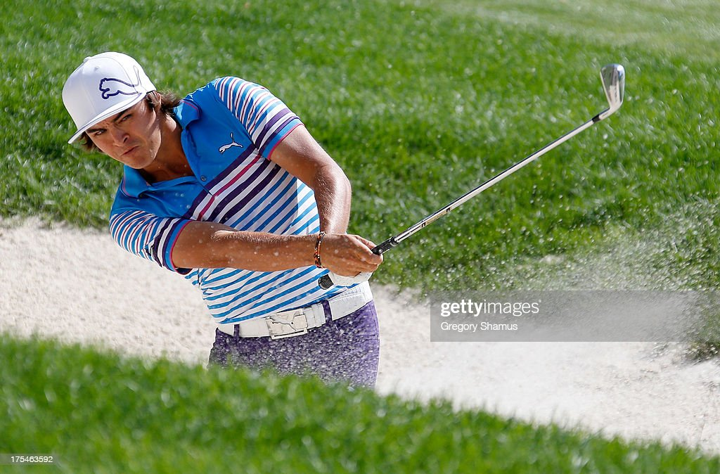 <a gi-track='captionPersonalityLinkClicked' href=/galleries/search?phrase=Rickie+Fowler&family=editorial&specificpeople=4466576 ng-click='$event.stopPropagation()'>Rickie Fowler</a> hits out of a bunker on the 16th fairway during the Third Round of the World Golf Championships-Bridgestone Invitational at Firestone Country Club South Course on August 3, 2013 in Akron, Ohio.