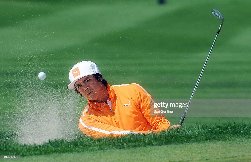 Rickie Fowler hits out out of a greenside bunker on the third hold during the final round of the Honda Classic in Palm Beach Gardens, Florida, Sunday, March 3, 2013.