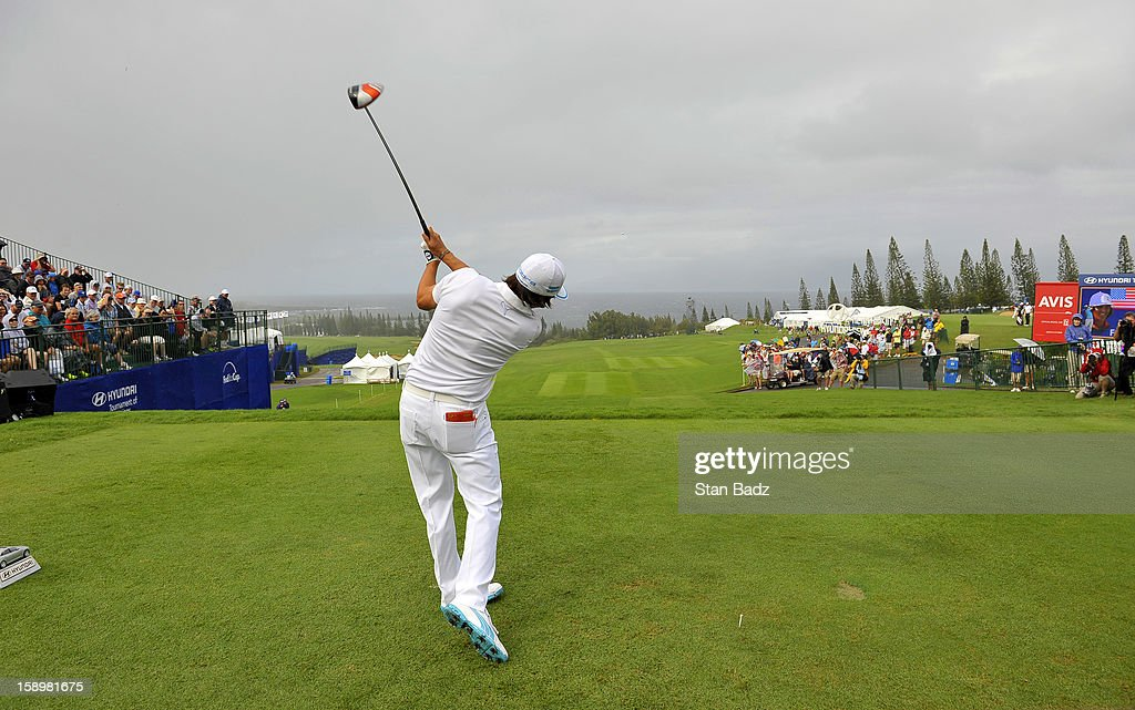 Rickie Fowler hits the 2013 opening golf shot for the season during the first round of the Hyundai Tournament of Champions at Plantation Course at Kapalua on January 4, 2013 in Kapalua, Hawaii.
