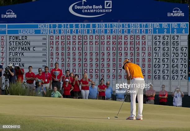 Rickie Fowler hits the first of two putts on the 18th green to win the Deutsche Bank Championship at TPC Boston in Norton MA on Sep 7 2015