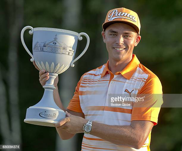 Rickie Fowler holds up the trophy after winning the Deutsche Bank Championship at TPC Boston in Norton MA on Sep 7 2015