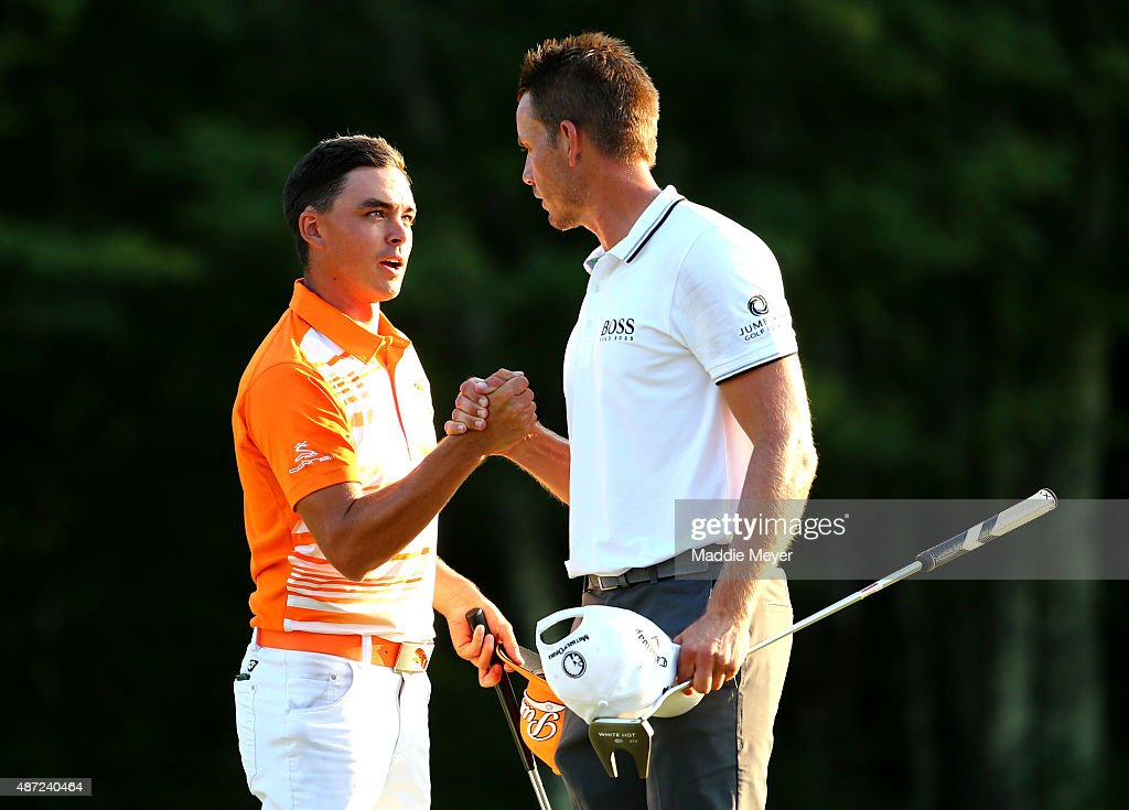 Rickie Fowler is congratulated by Henrik Stenson of Sweden after winning the Deutsche Bank Championship by onestroke over Henrik Stenson of Sweden at...