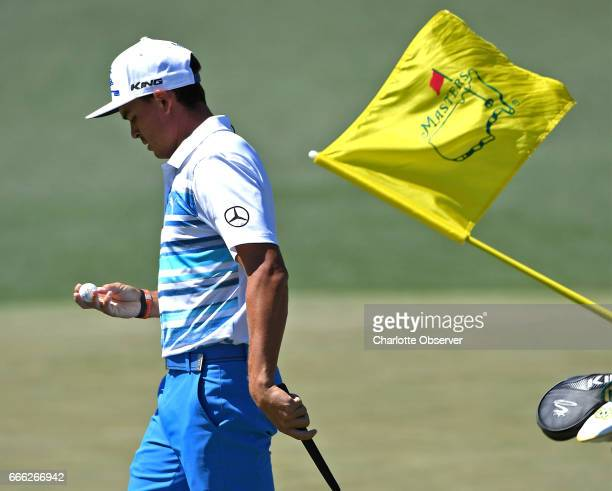 Rickie Fowler looks at his ball after putting on the 2nd green during the third round of the Masters Tournament at Augusta National Golf Club in...