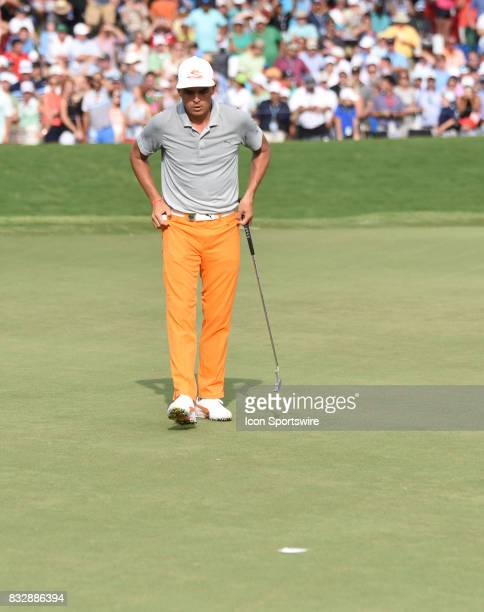 Rickie Fowler looks over his putt line on the 18th hole during the final round of the PGA Championship on August 13 2017 at Quail Hollow Golf Club in...