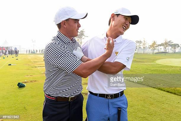 Rickie Fowler of Team USA left and Danny Lee of New Zealand on the International Team share a laugh on the range during practice for The Presidents...