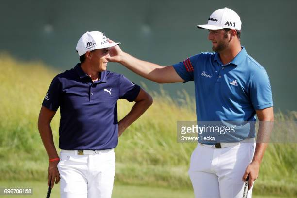 Rickie Fowler of the United State and Jon Rahm of Spain meet on the tenth green during the second round of the 2017 US Open at Erin Hills on June 16...