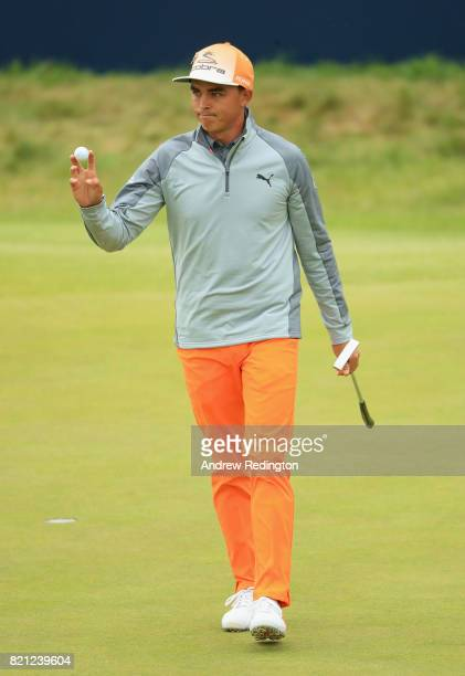 Rickie Fowler of the United States acknowledges the crowd on the 18th hole during the final round of the 146th Open Championship at Royal Birkdale on...
