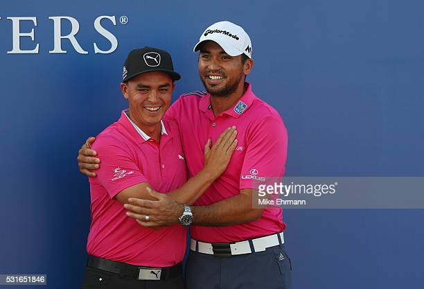 Rickie Fowler of the United States and Jason Day of Australia celebrate after Day won the final round of THE PLAYERS Championship at the Stadium...