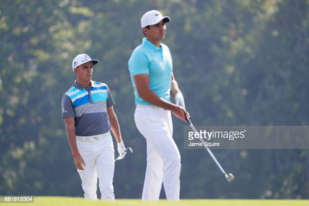 Rickie Fowler of the United States and Jason Day of Australia look on from the 14th hole during the first round of THE PLAYERS Championship at the...