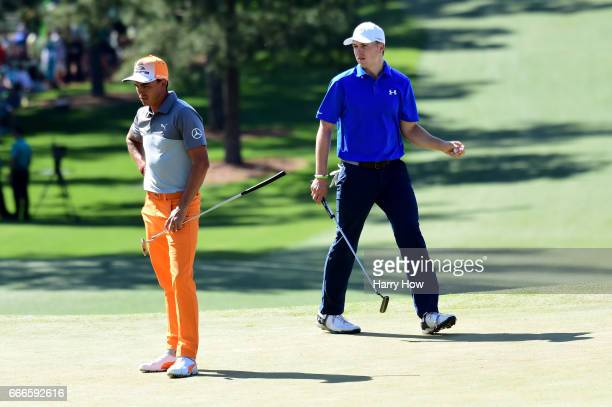 Rickie Fowler of the United States and Jordan Spieth of the United States play the seventh hole during the final round of the 2017 Masters Tournament...